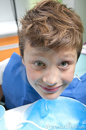 Boy drinking water after dental operation