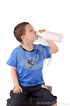 Boy drinks from a plastic bottle