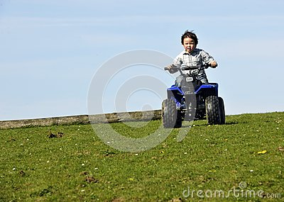 Boy driving ATV