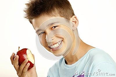 Boy eat apple