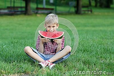 Boy eat watermelon