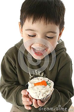 Free Boy Eating Carrot Cupcake Stock Image - 1767541