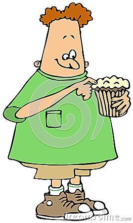 Boy eating a cupcake