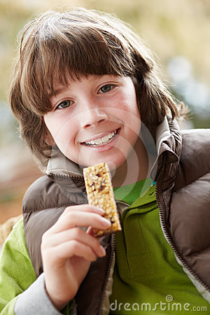Boy Eating Healthy Snack Bar