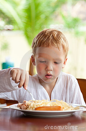 Free Boy Eating Spaghetti With Sausages Outdoors Stock Images - 17398774