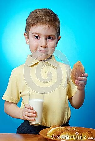 Boy eats homemade pie