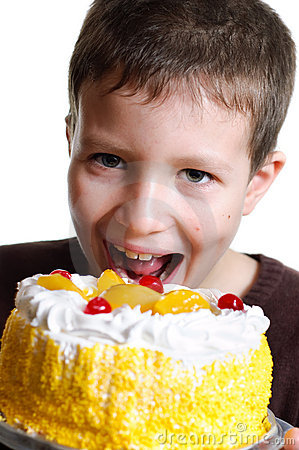 Boy eats a tasty cake