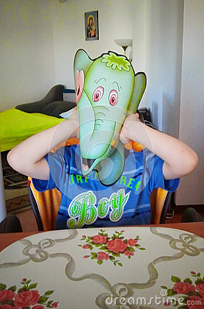 Boy with elephant mask