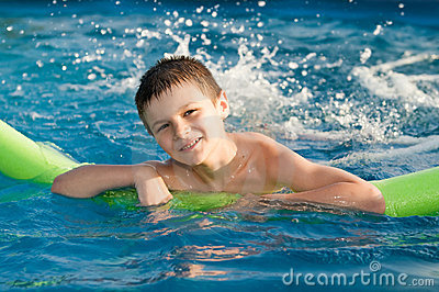 Boy enjoy in the pool