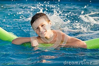 Boy enjoy in the pool