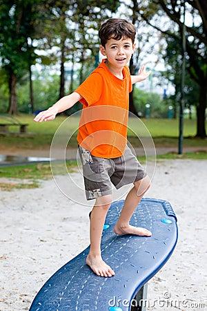 Boy enjoying balancing beam