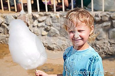 Boy enjoyong  cotton candy