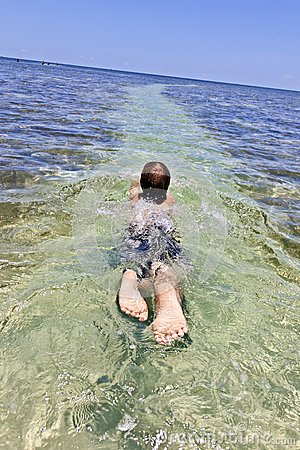 Boy enjoys the clear ocean