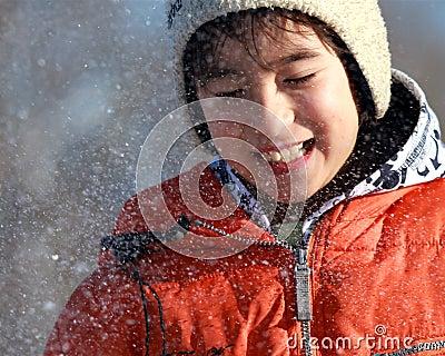 A boy enjoys a snow fight