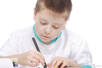 Boy examining object in lab