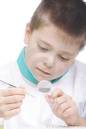 Boy examining object through magnifier