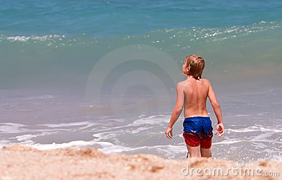Boy exploring beach