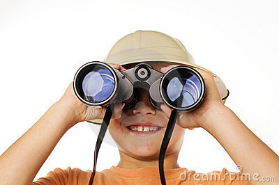 Boy exploring looking through binoculars
