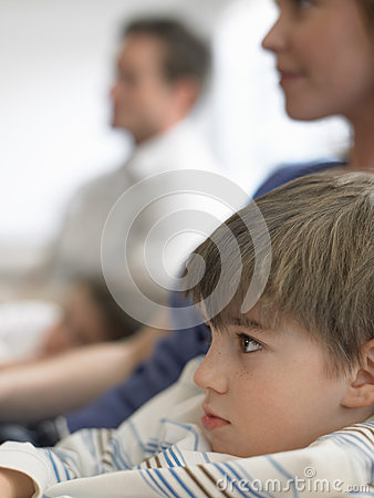 Boy And Family Watching TV At Home
