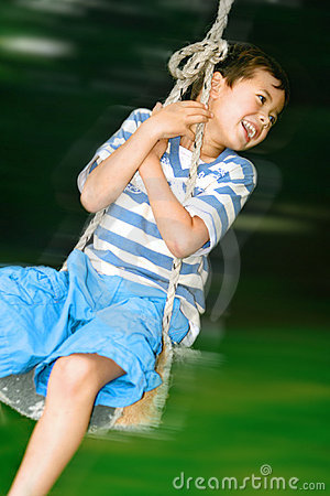 Boy on fast swing