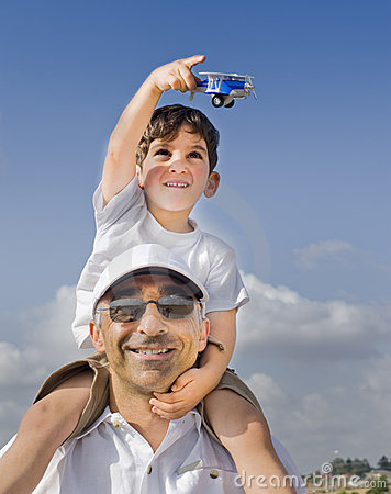 Boy on father shoulders with toy airplane