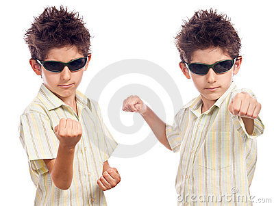Boy in fighting stance isolated white