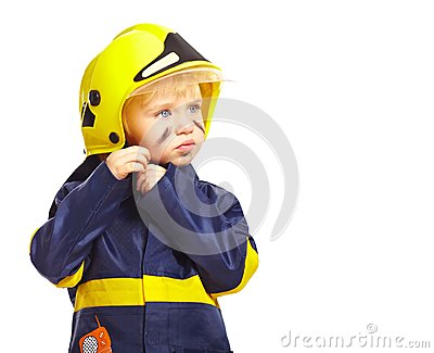 Boy in fireman costume with helmet
