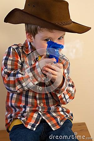 Boy firing cap gun