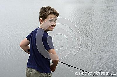 Boy fishing in bass lake