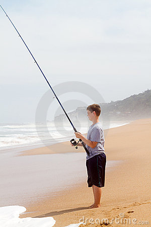 Boy fishing on beach
