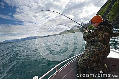 Boy fishing from boat