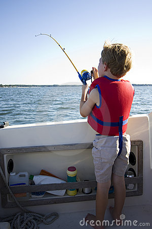Boy fishing from a boat.