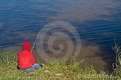 Boy fishing on lake