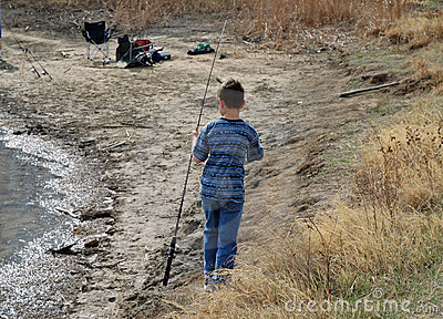 Boy with a Fishing Pole on the Shoreline