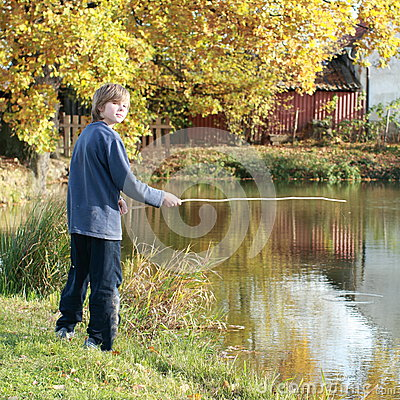 Boy fishing on pond