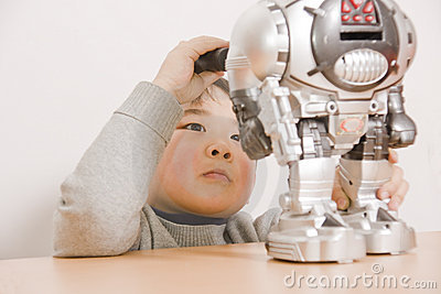 Boy fixing robot