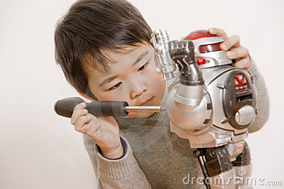 Boy fixing robot