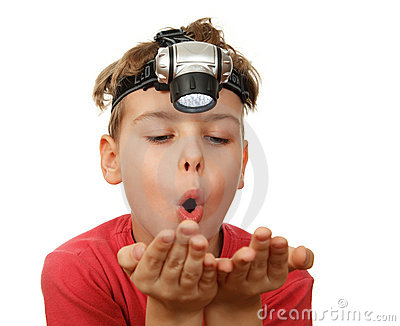 Boy with flashlight on his head on white
