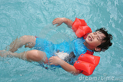 Boy floating in the pool