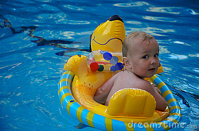 Boy floating in a swimming pool v2.0