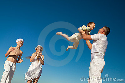Boy flying on his father s hands