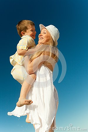 Boy flying on his mother s hands