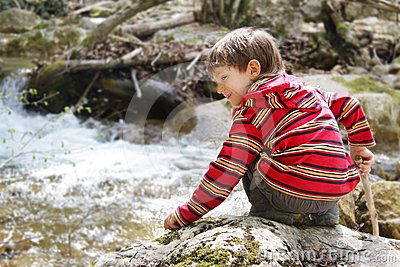 Boy on forest river