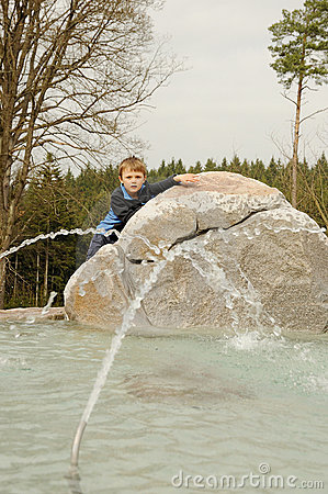 Boy on fountain
