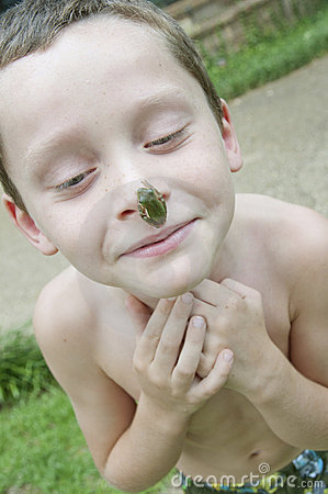 Boy with frog on nose