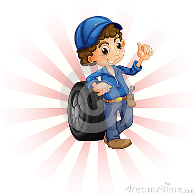 A boy in front of a wheel with a blue cap