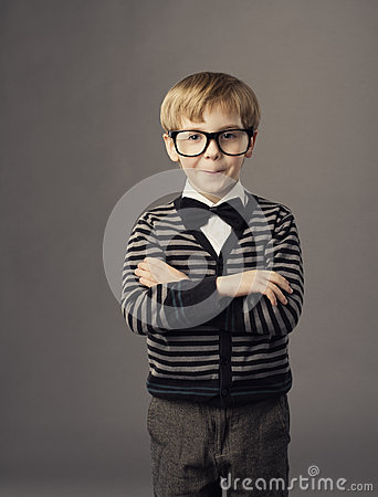Boy in funny glasses, little smat child fashion portrait