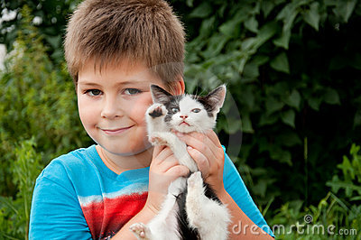 A boy and  funny kitten