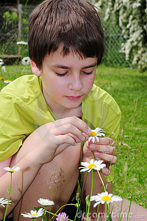 Boy in garden with flowers