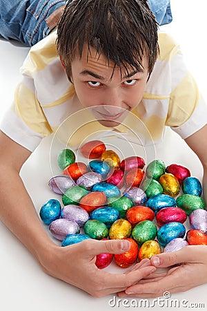 Boy gathering together easter eggs